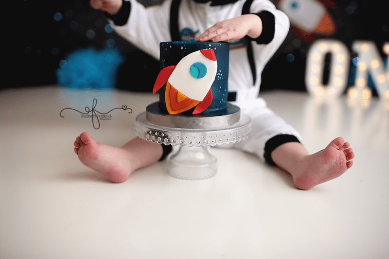 Out of this world smash cake photography session Astronaut Space first birthday